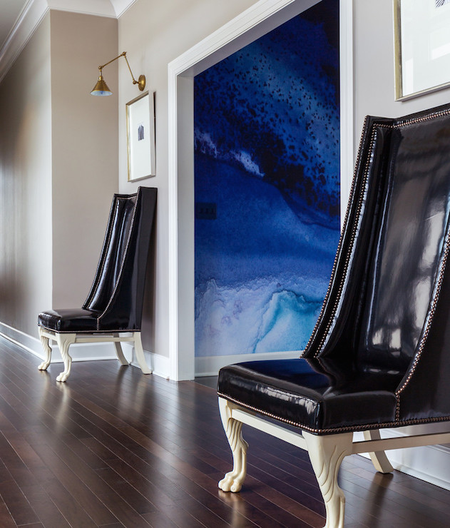 black-vinyl-wingback-chairs-greige-paint-colors-hallway-chairs